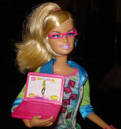 Barbie, from the waist up, displaying her laptop.
