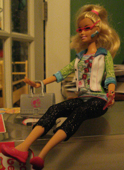 Barbie sitting on the box in different lighting